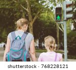 mother and daughter crossing...   Shutterstock . vector #768228121