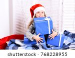 girl with cheerful face sits on ... | Shutterstock . vector #768228955