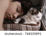 teenager boy and cat in cozy... | Shutterstock . vector #768235891