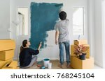 young asian couple painting... | Shutterstock . vector #768245104