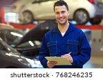 car mechanic in auto repair shop | Shutterstock . vector #768246235