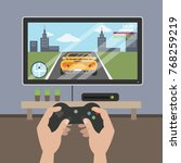 playing racing videogame on tv... | Shutterstock .eps vector #768259219