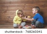 children eating donuts. happy... | Shutterstock . vector #768260341