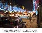 Small photo of Paris Taxi on a Road with lot of cars and lot of lights