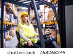 woman warehouse worker with... | Shutterstock . vector #768268249