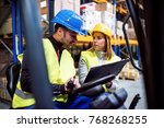 young warehouse workers working ... | Shutterstock . vector #768268255