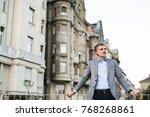mature businessman in a city. | Shutterstock . vector #768268861