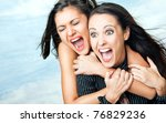 two beautiful girls hugging and ...   Shutterstock . vector #76829236