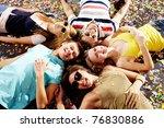 below angle of group of happy... | Shutterstock . vector #76830886