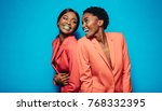 laughing young women in stylish ... | Shutterstock . vector #768332395