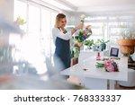female florist at work... | Shutterstock . vector #768333337