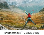 jumping man with backpack hands ... | Shutterstock . vector #768333409
