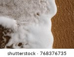 calm incoming wave | Shutterstock . vector #768376735