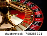 Small photo of Gambling, casino games and the gaming industry concept with seventeen the winning number, 17 is a black number on the roulette wheel