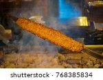 rows of juicy beef kebab... | Shutterstock . vector #768385834