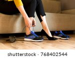woman changing high heels ... | Shutterstock . vector #768402544