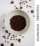 Coffee Beans On White Plate An...