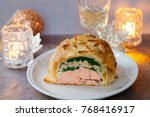 salmon en croute with spinach... | Shutterstock . vector #768416917