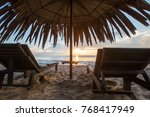sun loungers with umbrella on... | Shutterstock . vector #768417949