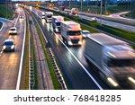trucks on four lane controlled... | Shutterstock . vector #768418285