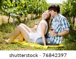couple at a picnic in vineyard | Shutterstock . vector #76842397