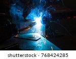 worker welding construction by... | Shutterstock . vector #768424285