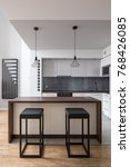 modern kitchen with table ... | Shutterstock . vector #768426085