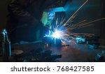 worker welding construction by... | Shutterstock . vector #768427585