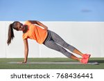 Small photo of Side plank fitness woman training body core planking exercise. Workout at outdoor gym or home garden Asian girl exercising obliques abs muscles with yoga pose plank.