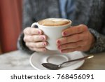 female hands with red heart on... | Shutterstock . vector #768456091
