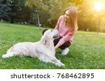 photo of brunette with dog... | Shutterstock . vector #768462895