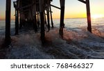 rushing water underneath a dock. | Shutterstock . vector #768466327