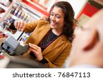 Shop Assistant Smiling While...