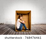 sad young woman inside a box on ... | Shutterstock . vector #768476461