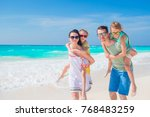 happy beautiful family on white ... | Shutterstock . vector #768483259