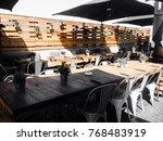 restaurant with wooden table | Shutterstock . vector #768483919