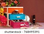 Jewelry In A Multi Colored Box...