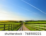 wooden fence casting shadows on ... | Shutterstock . vector #768500221