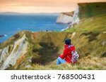 tourist enjoying view of man o... | Shutterstock . vector #768500431