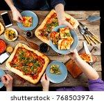 homemade pizza is eaten in the... | Shutterstock . vector #768503974