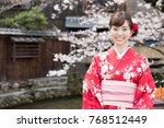 attractive asian woman wearing...   Shutterstock . vector #768512449