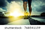 close up feet with running... | Shutterstock . vector #768541159