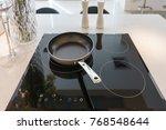 frying pan on modern black... | Shutterstock . vector #768548644
