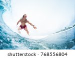 Small photo of Young surfer rides the perfect tropical ocean wave. Extreme sport and active lifestyle concept. Surfspot named Jailbreak, Maldives