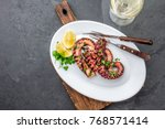 grilled octopus on white plate... | Shutterstock . vector #768571414
