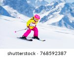 child skiing in mountains.... | Shutterstock . vector #768592387