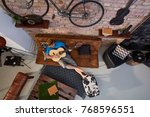 man in hat resting on sofa at... | Shutterstock . vector #768596551