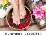 closeup shot of a woman feet... | Shutterstock . vector #768607564