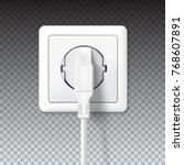 the plug is plugged into the... | Shutterstock .eps vector #768607891