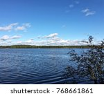 a calm quite tranquil lake with ... | Shutterstock . vector #768661861